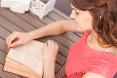Top view of woman reading book in cafe Royalty Free Stock Photo