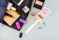 Top view of woman`s bag, cosmetic, makeup set, perfume bottle, c Stock Image