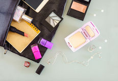 Top view of woman`s bag, cosmetic, makeup set, perfume bottle, r Stock Photo