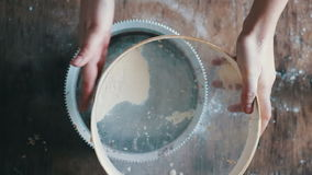 Top view of woman sieving flour in plate stock video footage