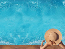 Top view of woman in straw hat relaxing in swimming pool at luxu. Ry villa resort. Summer holiday idyllic background. Vacations Concept. Exotic Paradise Stock Images