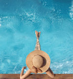 Top view of woman in straw hat relaxing in swimming pool at luxu. Ry villa resort. Summer holiday idyllic background. Vacations Concept. Exotic Paradise Stock Photography