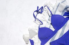 Top view of woman swimwear on the striped towel, shuttlecocks as a symbol od active vacantion, sport on the beach.Empty space for stock images