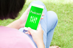 Top view of woman using her mobile phone with multimedia music b royalty free stock photos
