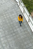 Top view of woman walking on the street and talk to cellphone Royalty Free Stock Photography