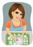 Top view of woman washing dirty dishes in kitchen. Woman doing housework at home Royalty Free Stock Photography