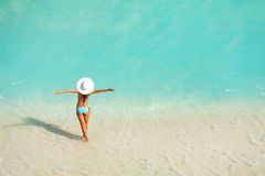 Top view of woman with white hat standing in ocean Royalty Free Stock Images