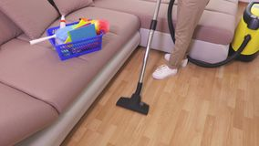 Top view on woman who clean floor with vacuum cleaner. In room stock video footage