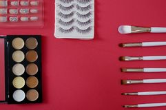 Top view of women's cosmetic on red background stock photo