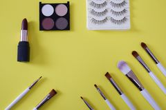 Top view of women's cosmetic on yellow background royalty free stock image