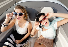 Top view of women in the cabriolet. Top view of happy women with sunglasses sitting in the cabriolet Stock Image