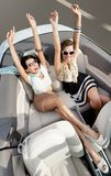 Top view of women in the cabriolet with their hands up Stock Photography