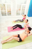Top view of women doing abdominal crunches at gym Stock Image