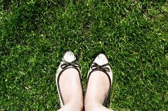 Top view of women`s beige shoes that stand on the green cut grass royalty free stock photos