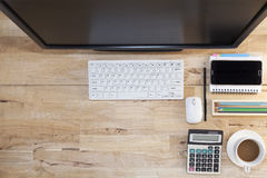 Top view with wood table, computer with keyboard,paper note,penc Stock Images
