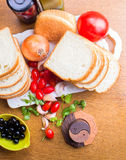 Top-view of a wood table with olives tomatoes bread Royalty Free Stock Photo