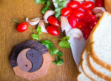 Top-view of a wood table with olives tomatoes bread Royalty Free Stock Photography