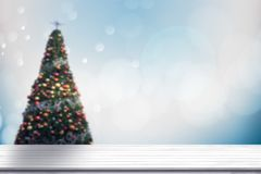 Top view wood table on soft blur abtract blue and white bokeh an. D Christmas  background, can be used to present products Royalty Free Stock Images
