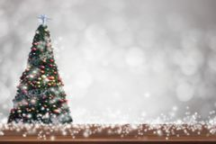 Top view wood table on soft blur abtract gray and white bokeh an. D Christmas tree background, can be used to present products Stock Photo