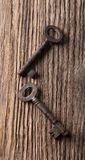 Top view on wooden board with two old keys Stock Photography