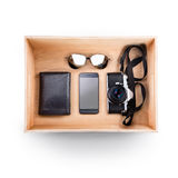 Top view of wooden box. Set of diferent things inside Stock Images