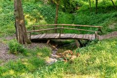 Top view wooden bridge over small river.  stock photography
