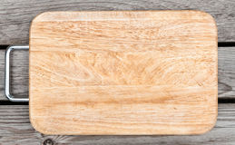 Top view of wooden cutting board on old  table Stock Photos