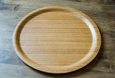 Top view of wooden dish on weathered wooden background stock images