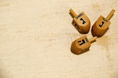 Wooden dreidels for hanukkah on vintage background Stock Photo