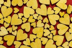 Top view of wooden hearts on red background pattern.  Valentine`s Day. stock photos