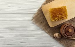 Top view of wooden honey jar and honeycomb on wooden board with copy space stock photos