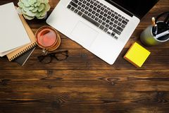 Top view wooden office  desk  with copy space. Image royalty free stock photography