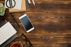Top view wooden office  desk  with copy space. Image royalty free stock image