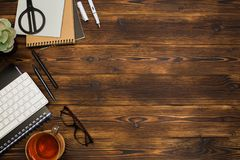 Top view wooden office  desk  with copy space. Image stock photography