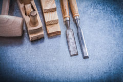 Top view of wooden planer hammer stud chisels Royalty Free Stock Photography