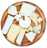 Top view of wooden plate with various cheeses Royalty Free Stock Photos