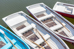 Top view of wooden rowboats floating around the dock. Stock Photos