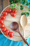Top view of wooden spoon and tomato Royalty Free Stock Images