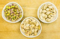 Top view of a bowl with pistachios in a shell, shell and a shelled nut. stock photography