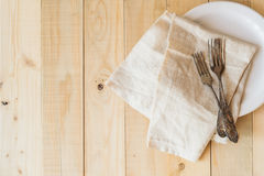 Top view wooden table setting with copyspace, three antique forks Royalty Free Stock Photography