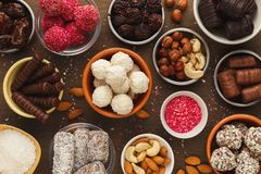 Wooden desktop with assortment of healthy sweets and nuts stock photo