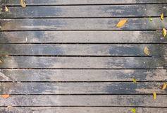 Top view of wooden walkway bridge with dry leaves Royalty Free Stock Image