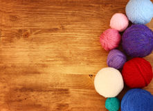 Top view of wool balls over wooden table Royalty Free Stock Photography