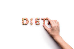 Top view of word diet made from sweets and human hand Stock Photo