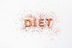 Top view of word diet made from sweets isolated on white Royalty Free Stock Photo