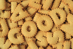 Top view of the word GOOD spelled with alphabet shaped biscuits on heap of the same biscuits stock photo