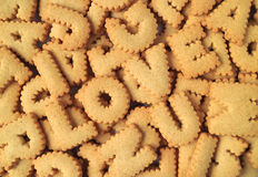 Top view of the word I LOVE U spelled with alphabet shaped biscuits on the pile of same biscuits Royalty Free Stock Images