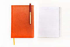Top view of work place concept. Diaries isolated on the white ba Stock Photo
