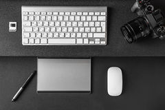 Top view of Work space on dark table of a creative designer or p Royalty Free Stock Photos