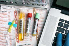 Top view of a work table of lab with test tubes for analysis and Stock Photography